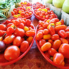 Globe/T. Rob Brown A variety of grape, pear, cherry and black cherry tomatoes in the Nhia & Ying Xiong, of Anderson, produce booth Friday morning, June 29, 2012, at the Webb City Farmers' Market.