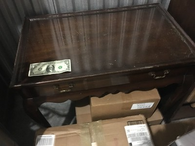 Side table. Dollar bill for scale.