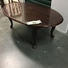Oval coffee table. Could use refinishing, but sturdy.