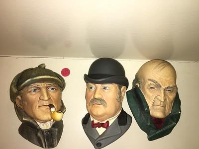 Bosson chalkwork heads: Sherlock, Watson, and Moriarty.