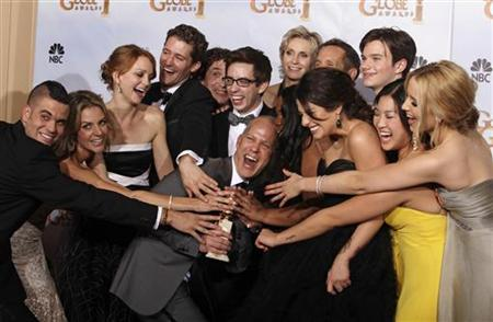 """""""Glee"""" creator Ryan Murphy (C) and the cast celebrate backstage with their award after winning for best television series-comedy or musical at the 67th annual Golden Globe Awards in Beverly Hills, California January 17, 2010.   REUTERS/Lucy Nicholson"""