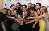 """Glee"" creator Ryan Murphy (C) and the cast celebrate backstage with their award after winning for best television series-comedy or musical at the 67th annual Golden Globe Awards in Beverly Hills, California January 17, 2010.   REUTERS/Lucy Nicholson"