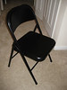 Metal folding chair, black $5