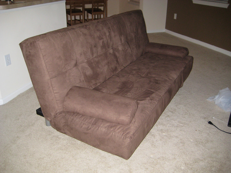 Couch = $200 (bought it for $400; it is a futon that bends two ways): the flash seems to have made many potential buyers think the couch is dirty. It's not; it's just the plush coating photographs really poorly. Trying again with no flash ...