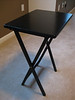 "Black wood foldable table stand = $10. Approx 18""W x 14""D x 26""H."