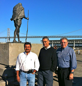 Dr. Somen Nandi, Mr. Somu Kumar and Dr. Ray Rodriguez outside the Ferry Building in San Francisco September, 15, 2012. Gandhi statue and Bay Bridge in the background.