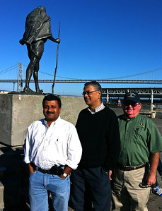 Dr. Somen Nandi, Mr. Somu Kumar and Dr. James Cullor outside the Ferry Building in San Francisco September, 15, 2012. Gandhi statue and Bay Bridge in the background.