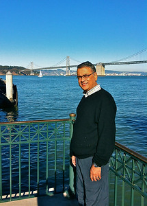 Mr. Somu Kumar outside the Ferry Building in San Francisco September, 15, 2012.  Bay Bridge in the background.