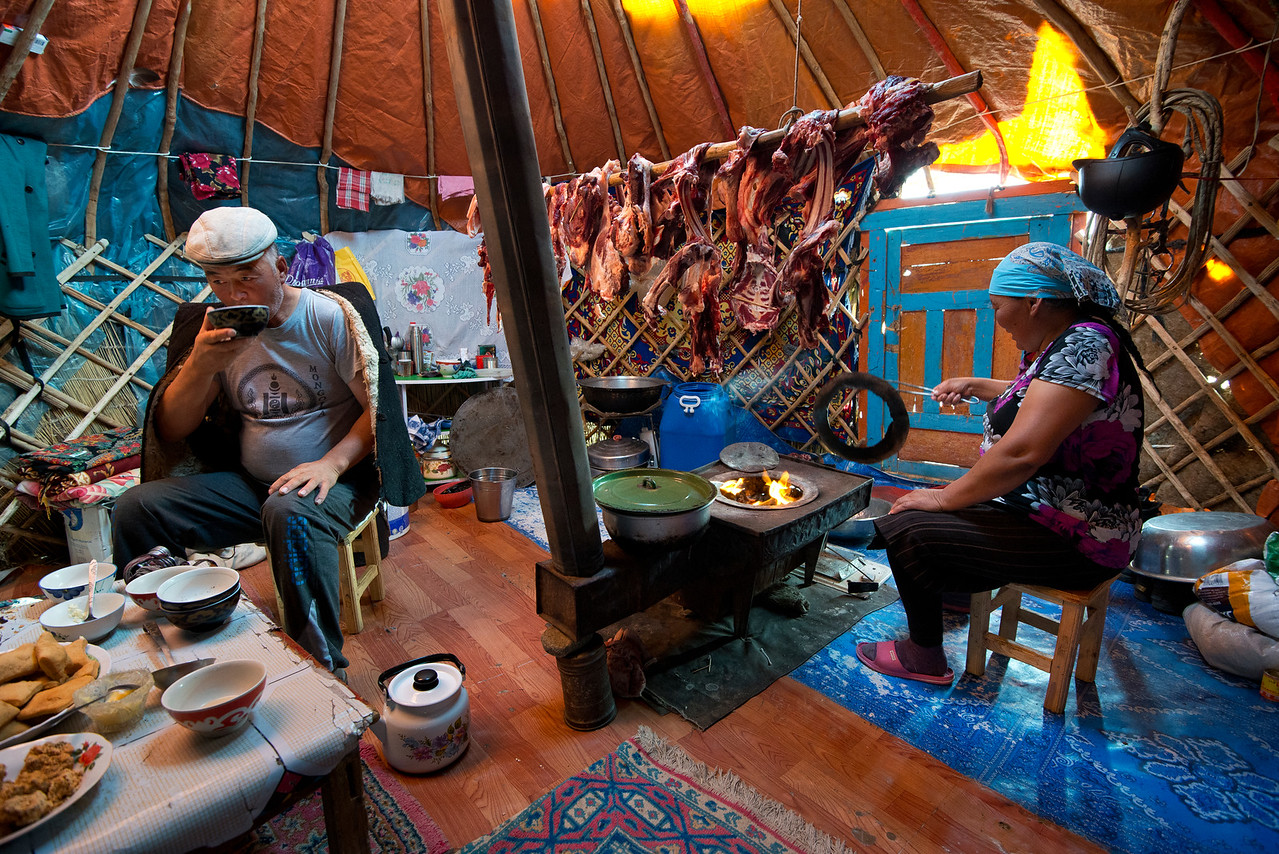 Mr Shamurat and his family own two yurts. A large one which they use for sleeping, and a smaller one which they use for cooking, gatherings and food storage. The family kills approximately twenty-five sheep and goats per year for food. He always kills 15 of them in November and hangs the meat in the yurt  for the winter before the animals get thin. <br /> Mr Shamurat is always in charge of killing the animals himself by cutting their throats and letting them bleed to death. It's the halal way. He also makes use of the hide which is made into clothes, rugs or accessories for the horses. Even the stomach is used. It is dried, and serves as a container. The best and leanest parts of the animal are usually left to dry inside the yurt for future use, whereas the entrails are used for stew.