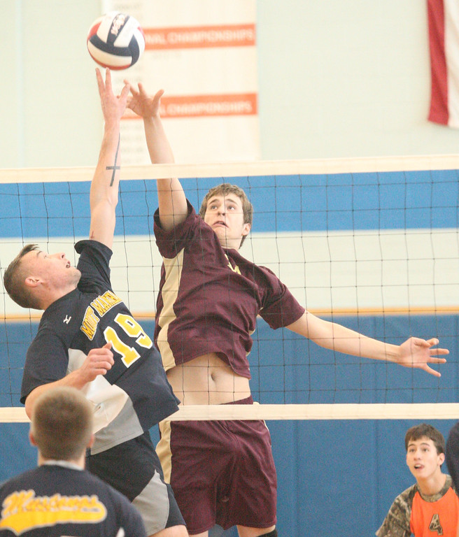 . Mount Markham\'s Zach Brown (19) and Canastota\'s Michael McDermitt (24) battle above the net for the ball during the Section III Class C final in Oneida on Thursday, March 6, 2014. JOHN HAEGER - ONEIDA DAILY DISPATCH @ONEIDAPHOTO ON TWITTER