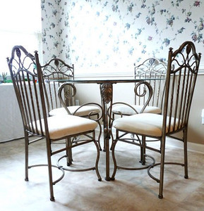 Immaculate iron and glass dining table and chairs