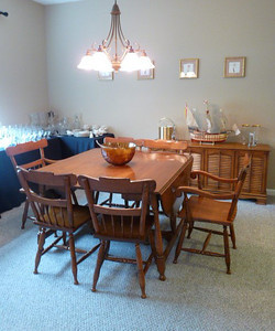 Maple drop leaf dining set w/several leaves and custom table pads.