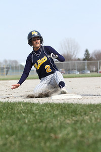 Ken Kadwell/@KenKadwell - Special to the Sun Mt. Pleasant Oiler Jordan Hyames (2) steals third base against Bay City Central at Mt. Pleasant Thursday, April 17, 2014.  Final Score 15-0 Mt. Pleasant.