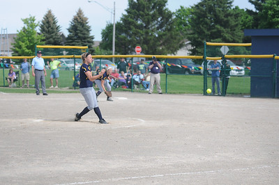 Mt. Pleasant senior Sydney Epple delivers a pitch in the third inning of Mt. Pleasant's 4-0 loss to Saginaw Swan Valley on Wednesday, May 28, 2014.  Joe Buczek - The Morning Sun