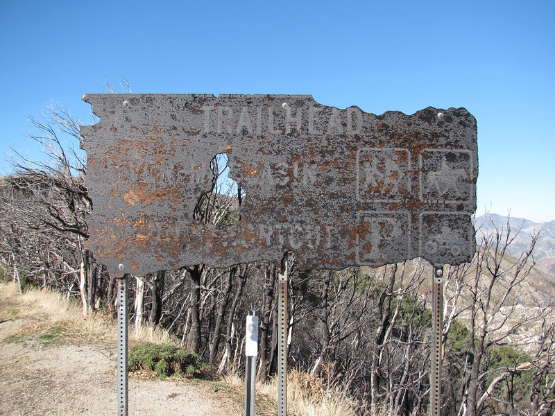 Two years later the trail head signs is evidence of the station fire.