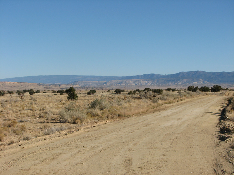Looking towards the Jemez Mtns.  Hwy 550 would be near the white cliffs in the middle of the photo.