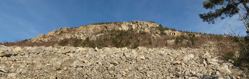 The rock slide and cliff face of Whitewall from the Ethan Pond trail
