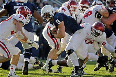 Penn State running back Michael Zordich (9) gets past Indiana linebacker David Cooper, right, for a touchdown during the fourth quarter of an NCAA college football game in State College, Pa., Saturday, Nov. 17, 2012. Penn State won 45-22. (AP Photo/Gene J. Puskar)