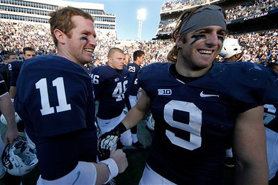 Penn State quarterback Matt McGloin (11) and running back Michael Zordich (9) celebrate after a 45-22 win over Indiana in an NCAA college football game in State College, Pa., Saturday, Nov. 17, 2012. (AP Photo/Gene J. Puskar)