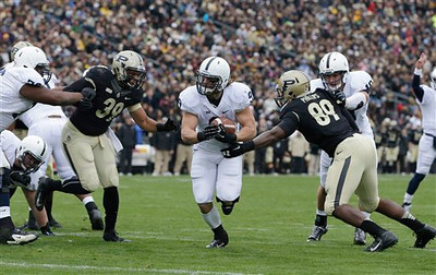 Penn State's Michael Zordich goes in for a six yard touchdown run against Purdue's Joe Gilliam (39) and Jalani Phillips (89) during the first half of an NCAA college football game Saturday, Nov. 3, 2012, in West Lafayette, Ind. (AP Photo/Darron Cummings