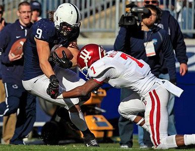 Indiana cornerback Brian Williams (7) makes the tackle on Penn State running back Michael Zordich (9) during the second quarter of an NCAA college football game in State College, Pa., Saturday, Nov. 17, 2012. Williams injured his hand on the play. (AP Photo/Gene J. Puskar)