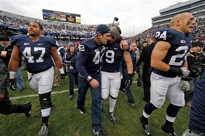Penn State defensive lineman Jordan Hill (47), linebacker Michael Mauti (42), running back Michael Zordich (9) and running back Derek Day (24) walk off the field after a senior recognition ceremony before an NCAA college football game against Wisconsin in State College, Pa., Saturday, Nov. 24, 2012. (AP Photo/Gene J. Puskar)
