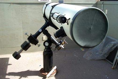 This end of the telescope shows the massive 2 inch focuser and finderscope (both visible on the left side of the tube.)  The large plastic cover is on the telescope tube when this picture was taken to protect the optics.