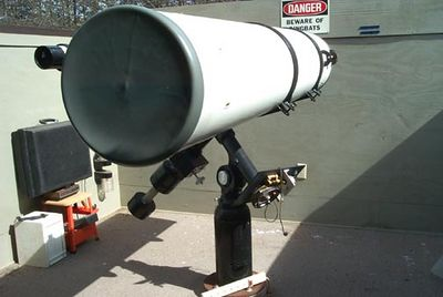 "Another image of theis ""huge"" telescope. Notice the cord on the electric plug for the ""clock drive. The drive moves the telescope very slowly and keeps the object from drifting out of the telescopes eyepiece."