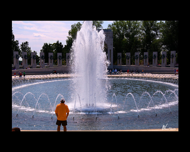 Day 111: World War II Memorial Fountain<br /> <br /> This was taken at the World War II Memorial in Washington DC. I don't know who the man is looking into the fountain but I thought it added to the photo to see him doing it.