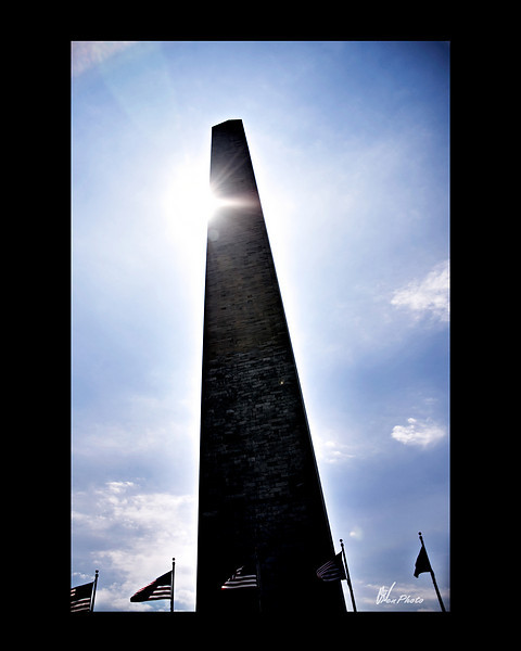 Day 109: Shining Monument<br /> <br /> I have taken many pictures of the Washington Monument and this may not be my favorite but I think it is a bit different from most. Instead of seeing it reflecting in the pool, it is darkened by the brilliance of the sun shining from behind it.