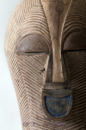 Detail of African mask carved in wood.