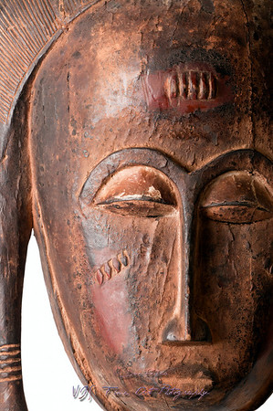 Detail of a Baule female mask from Ivory Coast/Africa, carved in wood with pigment/kaolin patina; small splits, scrapes and cracks attest to its age/use.