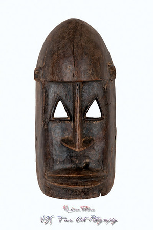 Dogon mask from Mali, carved in wood; small splits, scrapes and cracks attest to its age/use.