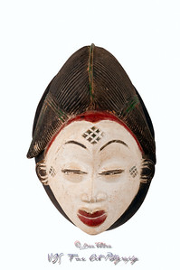 Detail of a Punu female mask from Cameroon/Africa, carved in wood with white pigment signifying anti-witchcraft powers; small splits, scrapes and cracks attest to its age/use.