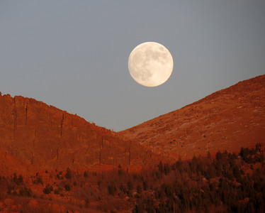 I caught the moon rising over the mountains today...it was an awesome sight!