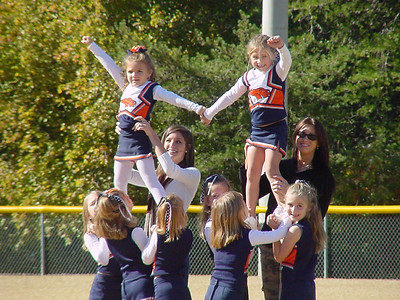 Susie (Assistant coach) in white top, couching her youth cheerleading team.