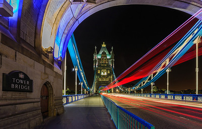 Tower Bridge in London with double-decker bus and vehicle trails
