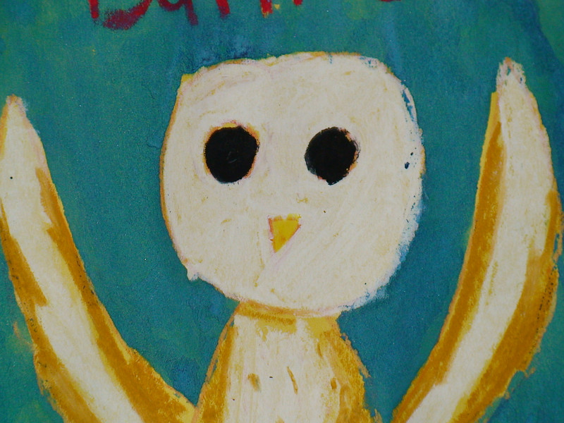 A detail of a mixed-media painting Cecilia did of a barn owl.  She came up with this idea to cover the paper with crayon, ink, and paint and then scrape some off and apply some more paint for this effect.  It is obvious Cecilia is an artistic genius.