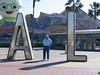 "Dad posing by the ""California"" sign at Disney's California Adventure"