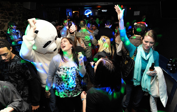 Marshall Sheperad, left, dances with his girlfriend Erin McLaughlin both of Bel Air while wearing a panda head at Dockstreet Bar & Grill. (Photo by Shannon Lee Zirkle - The Capital) 12/14/2010