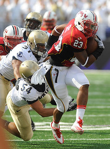 Maryland's Da'Rel Scott carries the ball down the field during the game against Navy held at M&T Bank Stadium. (Photo by Shannon Lee Zirkle - The Capital)
