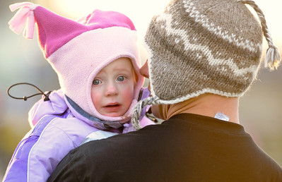 Eloise Sosnowski, 1 is so cold that she sheds a tear. Eloise is comforted by her dad John during the Army Navy tailgate party and flag-football game held at Fort Meade's Mullins Field. (Photo by Shannon Lee Zirkle - The Capital) 12/8/10