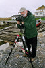 Me, in Peggy's Cove using my Fuji 6x9 range finder film camera.  Notice the excellent tripod technique with the center post extended. (Bad Bad!)   Okay it was easier to change roll  film if I moved the camera up so I could see the back better.