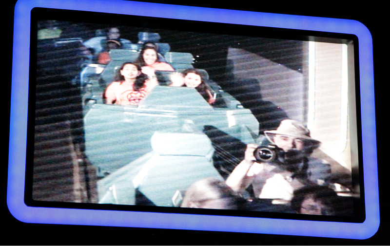 Who else would take a camera on a fast ride at Disney World?