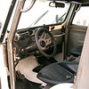 Left interior. Stainless steel roll cage, dash and grab bar