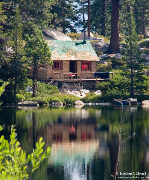 cabin in the woods near lake