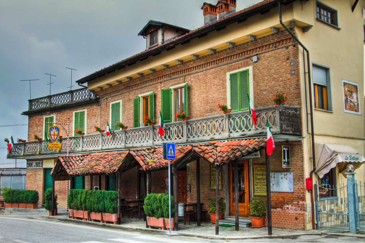 Several different businesses here under one roof, a small market, a tasting room and del Buon Padre restaurant. 3 handheld exposures taken a few hours before the rain arrived. Vergne/Barolo, Cn, Piemonte, Italia
