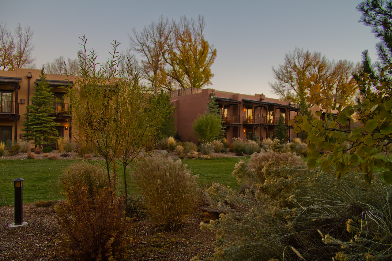 Night falls on the grounds at El Monte Sagrado in Taos, New Mexico, one of our favorite homes away from home.