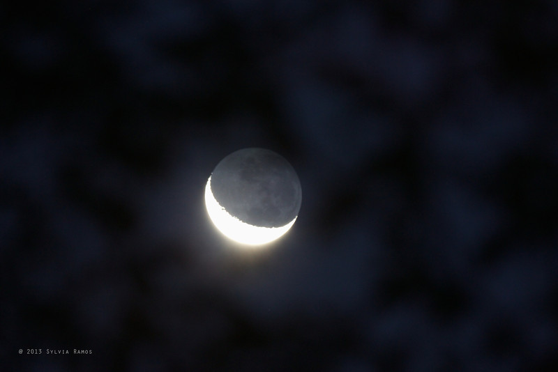 The moon, shot through some clouds.<br /> <br /> 14 February 2013 <br /> Valencia, Dumaguete, Philippines