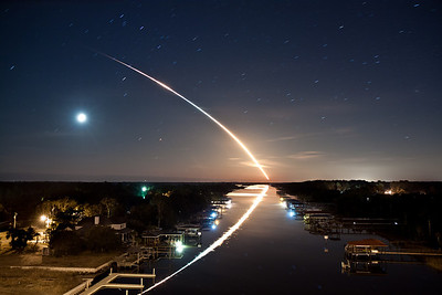"""02/08/2010 at 4:14 am - STS-130 Space Shuttle Endeavor launch from the Intracoastal Waterway Bridge in Ponte Vedra, Florida; about 115 miles from the launch pad. This launch was extra special because it is NASA's last scheduled night launch of the space shuttle program.  The response to this photo has been absolutely amazing.  The photo has generally become known as """"Waterway to Orbit"""", thanks to Jerry Bonnell of the NASA Astronomy Picture of the Day.  I wanted to use this space to answer a few questions that have been emailed to me and that I have seen on the web.  (I admit it, I googled myself :D ).  If you have further questions or comments, or if you would like to be added to my mailing list, please feel free to  email me or leave a comment on this page.  What type of camera did you use and what were your settings for this picture? I used a Canon EOS Rebel T1i , with a Canon EF-S 17-55mm f/2.8 IS USM Lens   attached; no filters. I was pretty sure I had it set to 17mm but exif shows 18mm.  Maybe it creeped a bit while I was rushing to decide the exposure and composition.  Exposure was ISO 100, f/4, and 132 seconds.  Please let me know when I can purchase a copy. Hope it is soon. The photo is finally available for purchase!  Click the """"Buy"""" button at the top of this page to purchase a copy.  I priced them reasonably so as not to exclude anyone who is interested in purchasing.  Thanks so much for all of your interest and patience.  I am truly humbled.  Are you interested in licensing it for commercial projects? Absolutely.  Please  contact me if you are interested.  Have you altered the photo in any way?  Also how much post-production editing did you do to adjust the colors, etc. I did not alter the content of the image at all.  Really the only thing I did was some slight adjustments to white balance, exposure, clarity, vibrance and contrast in Adobe Lightroom.  Incredible shot. How much of that was pure luck or great planning?  I have always heard that in photogra"""